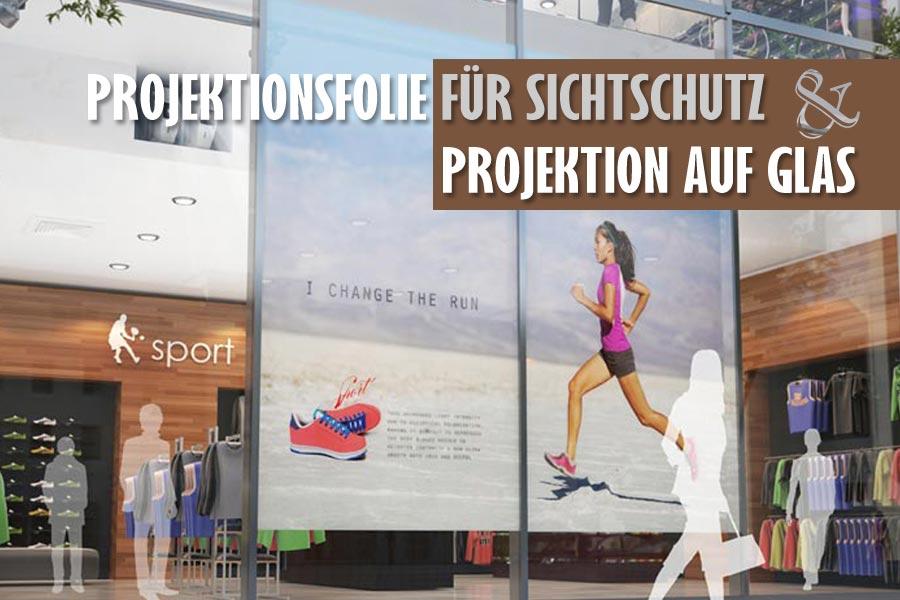glastrennwand in shoppingcenter mit sichtschutzfolie und projiziertem videobild